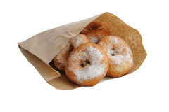 Fried donuts in a paper bag Royalty Free Stock Images