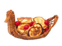 Fried donuts in a wicker basket Royalty Free Stock Images
