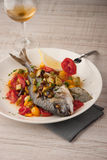 Fried dorado with vegetables  on the ceramic plate with glass of vine vertical Stock Images