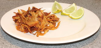 Fried dried anchovies with lemon. A plate of dried anchovies ready for breakfast Stock Image