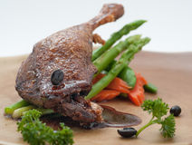Fried duck leg with morning glory Stock Images