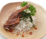 Fried duck leg with noodles Stock Photo