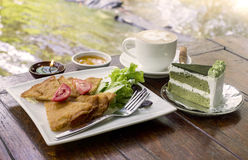 Fried dumpling cheese food snack with green tea cake and cappuccino coffee cup Stock Images