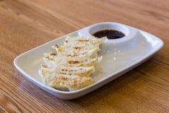 Fried Dumpling, gyoza on white plate. Royalty Free Stock Photos