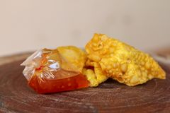 Fried dumplings,chinese food with sauce in plastic bag on wooden table stock image
