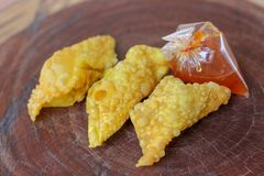 Fried dumplings,chinese food with sauce in plastic bag on wooden table royalty free stock photos