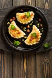 Fried dumplings with onion and bacon Royalty Free Stock Photography