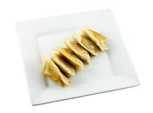 Fried dumplings on plate Stock Photos
