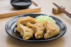 Fried dumplings on plate Stock Images