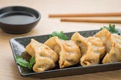 Fried dumplings on plate Stock Photos