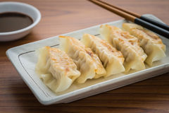 Fried dumplings on plate and soy sauce Royalty Free Stock Photography