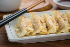 Fried dumplings on plate and soy sauce Royalty Free Stock Photo