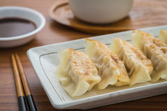 Fried dumplings on plate and soy sauce Stock Images