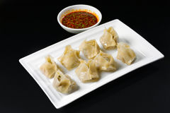 Fried dumplings with sauce Royalty Free Stock Images