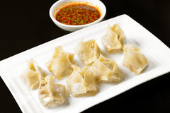Fried dumplings with sauce Royalty Free Stock Photo
