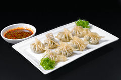 Fried dumplings with sauce Royalty Free Stock Photos