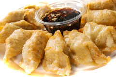 Fried dumplings. Yaki-Gyoza - Japanese pan-fried dumplings served with a soy based dipping sauce royalty free stock photography