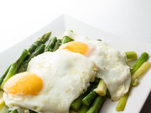 Fried egg Asparagus Royalty Free Stock Images