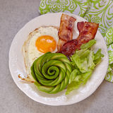 Fried Egg, Bacon and Avocado Rose for Breakfast. Fried Egg, Bacon and Avocado Rose. Low carb high fat breakfast Stock Images