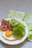 Fried Egg, Bacon and Avocado Rose for Breakfast. Fried Egg, Bacon and Avocado Rose. Low carb high fat breakfast Royalty Free Stock Images