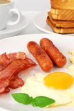 Fried egg and bacon for breakfast Royalty Free Stock Images