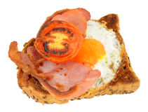 Fried Egg And Bacon With Grilled Tomato On Toast Stock Photos