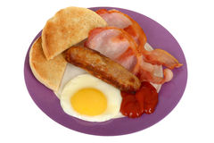 Fried egg with bacon and sausage Stock Photo