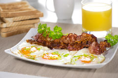 Fried egg with a bacon Royalty Free Stock Images