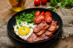Fried egg with bacon Royalty Free Stock Photo