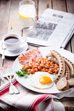 Fried egg with beans, bacon and grilled sausages Stock Photography