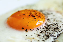 Fried egg with black pepper Stock Photography