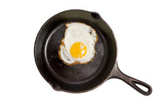Fried Egg in a Black Skillet Stock Images