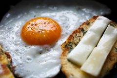 Fried egg and bread with cheese on the pan Royalty Free Stock Photography