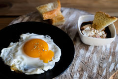 Fried egg with bread croutons and garlic sauce Stock Photography