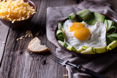 Fried egg and bread on wooden table Royalty Free Stock Photo