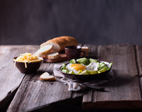 Fried egg and bread on wooden table Royalty Free Stock Images