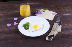 Fried egg for breakfast. Breakfast with a wish for the beloved. Stock Image