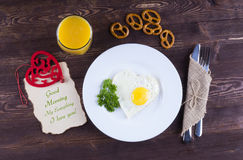 Fried egg for breakfast. Breakfast with a wish for the beloved. Stock Photos