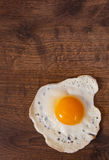 Fried egg on the brown wooden table background Royalty Free Stock Photography
