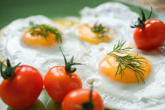 Fried egg with cherry tomatoes. Delicious and healthy breakfast. Sunny side up. Selective focus Stock Photography