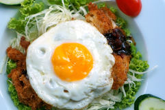 Fried egg with chicken and lettuce Stock Image