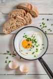 Fried egg with chives Stock Photo