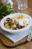 Fried egg, chorizo and potatoes Stock Photography