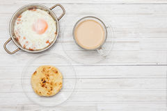 Fried egg, coffee and arepa Stock Photo