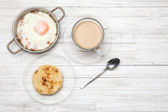 Fried egg, coffee and arepa Royalty Free Stock Image