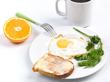 Fried egg, coffee and a toast Stock Image