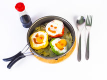 Fried egg on colorful peppers on pan Royalty Free Stock Photos
