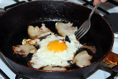 Fried egg during cooking Stock Photos