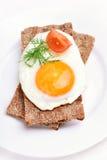 Fried egg on crispbread Stock Photography