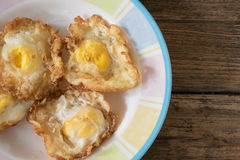 Fried egg. Crispy fried egg on a wooden table Stock Photos